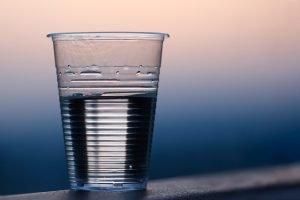 Half full clear plastic cup